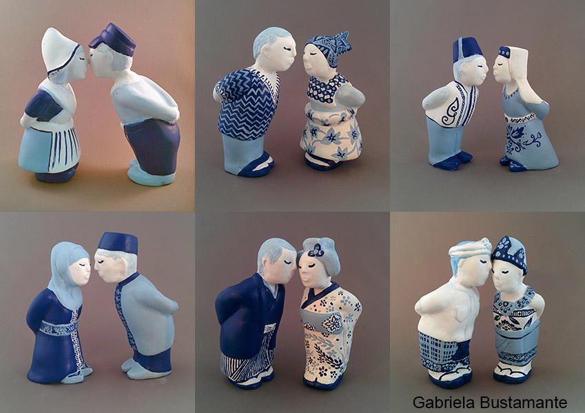 Figuren in Delfts blauw met verschillende etnische achtergronden geven elkaar een kus